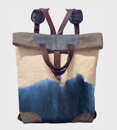 The inky indigo dye on this bag resembles a watercolor painting of the sea; the sturdy waxed canvas and leather straps make this bag perfect for totin' and ocean adventurin'.  Handmade by McLoveBuddy, every bag features a unique indigo dye pattern unlike any other.