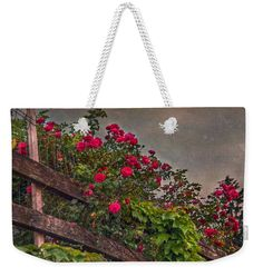 Fence Weekender Tote Bag featuring the photograph Blooming Fence by Hanny Heim…