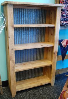 "Solid rustic style shelving unit upcycled from reclaimed wood and backed with corrugated roofing. Heavy and built to last. Perfect for storing all of your belongings!  Measures 60.5"" high x 37"" wide x 14.5"" deep  *NOTE: Only local pickup or local delivery is available for furniture. Please co..."