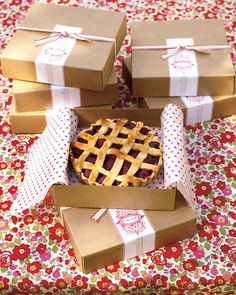 Miniature raspberry-blackberry tarts, packed in pie boxes and sealed with long stickers, are perfect for guests to tote home as favors.