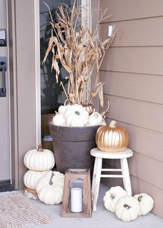 Can't wait to update your curb appeal for fall? Then check out this Rustic Metallic Fall Porch for inspiration on how to decorate your entryway space. Don't you just love these gold pumpkins mixed with corn stalks?!