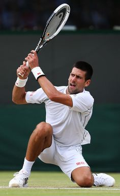 Novak gets low on the grass at Wimbledon
