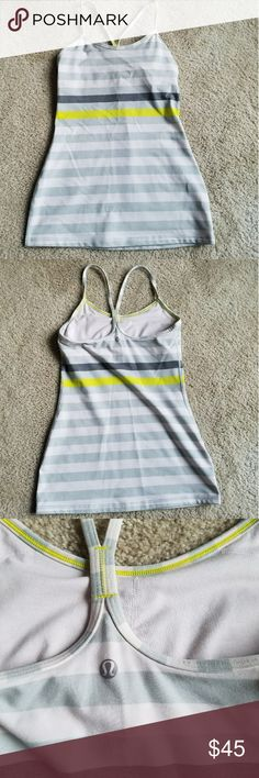 Lululemon Power Y tank Grey white and yellow stripe Lululemon power y style tank. Size 4 with built-in bra excellent condition! lululemon athletica Tops Tank Tops