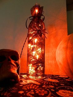 Halloween Wine Bottle Lamp...this is a cool idea. I love the idea of putting a string of lights in an alcohol bottle in general.