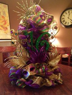 Celebrate Fat Tuesday with stunning Mardi Gras decorations. Check out Mardi Gras DIY Decorations ideas here. These are easy and best Mardi Gras decor ideas. Mardi Gras Centerpieces, Mardi Gras Decorations, Table Centerpieces, Disney Centerpieces, Masquerade Decorations, Birthday Centerpieces, Holiday Decorations, Wedding Centerpieces, Mardi Gras Wreath