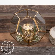 These geometric terrariums make the prettiest centerpieces! They can be filled with succulents, candle holders, flowers, stones, etc., to create your own stunning display.  These are gold with glass panels and one opening. They measure approximately 6 x 5.  We offer discount pricing on these for quantity, so you can buy one for each table and have the wedding of your dreams, without blowing your budget.  **We recommend using LED candles, but if you plan on using real wax candles, please note…