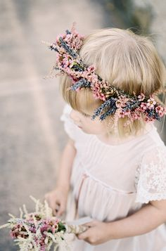 delicate floral circlet and posy in pretty pink and lavender for this flower girl