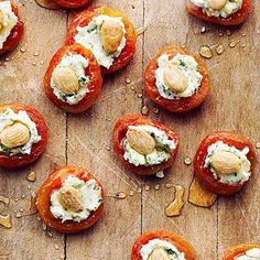 The perfect self-contained party snack: apricots with basil goat cheese and almonds.