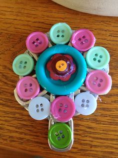 Button crafts super easy!!! Supples;  first, get soda can tabs, then u need buttons and last hot glue gun