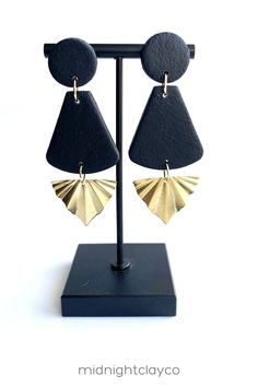 Black leather effects polymer clay earrings. Fan shaped dangle earrings with brass wavy dangles. These bohemian chic style earrings make the perfect accessory for a summer date night outfit. Give as a unique birthday gift for female friend, wife, or sister in law. Makes a great graduation gift! Shop these trendy handmade earrings for women in my etsy shop! Black Earrings, Circle Earrings, Round Earrings, Boho Jewelry, Etsy Earrings, Women's Earrings, Earrings Handmade, Unique Jewelry, Gifts For Female Friends