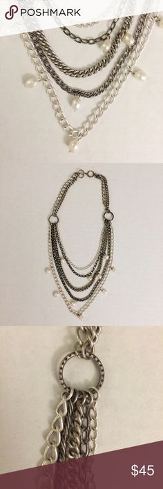 "Stella & Dot Avery pearl and chain necklace This Stella & Dot Avery chain and freshwater pearl necklace has a toggle closure and five  antiqued silver plated chains. The shortest chain is 18.25"" and the longest chain is 24"" in length. Lead and nickel safe. I've only worn this once, so I'm selling it because I never reach for it. Some slight tarnishing as shown in pic, but otherwise, in great condition. Stella & Dot Jewelry Necklaces"