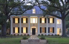 CURB APPEAL – another great example of beautiful design. White Bricks and Black Shutters is classic.