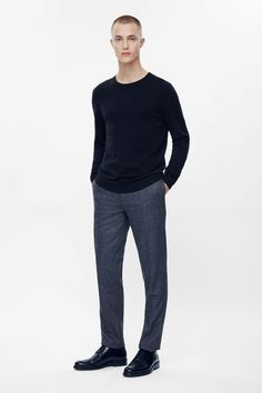 These straight-leg tailored trousers are made from lightly textured wool melange with a partial silky lining. A slim fit, they have pockets at the sides and back, neat press folds and a classic zip-fly fastening.