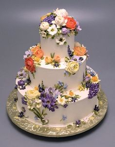 Stunning floral buttercream wedding cake by Cupcake Cafe in NYC. weddingcake-cupcakecafe-white.jpg