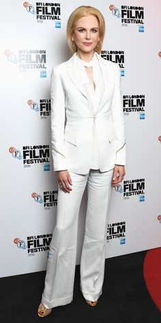 Nicole Kidman suited up for the Screen Talk event during the BFI London Film Festival, looking sharp in a crisp white blazer layered over a cut-out top and wide-leg pants. Delicate ball drop earrings and gold mesh Giuseppe Zanotti sandals completed her look.