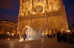 Sparks fly from a performance in front of Notre Dame, on the île de la Cité.