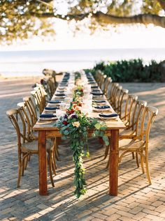 Intimate outdoor Maui wedding with a rustic tablescape and a large garland