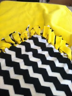 Easy Hand-Tied Fleece Blanket Tutorial-making these tonight with the kids to replace theirs from when they were little. Easy to make! I've done this at the orphanage too and getting ready to do it again with them.
