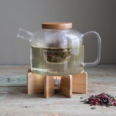 This glass teapot offers a removable infuser for perfect steeping and a bamboo stand with votive holder to keep your brew warm.