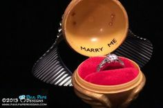 Harry Potter Golden Snitch engagement ring box from Paul Pape Designs. Check out the video.