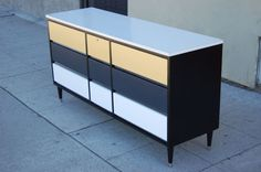 Graphic Mid-Century Modern Dresser with Nine Drawers | From a unique collection of antique and modern dressers at http://www.1stdibs.com/furniture/storage-case-pieces/dressers/