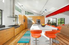 We like our eggs sunny side up . . . just like our favorite kitchen designs. Inspiration: Austin's Heimsath Architects and Tre Dunham Photography. #Austin