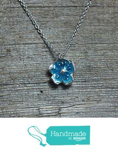 Blue glow in the dark flower blossom necklace from Earthly Creature Designs https://www.amazon.com/dp/B06XKRML1G/ref=hnd_sw_r_pi_dp_OjfYybE6SBAWV #handmadeatamazon