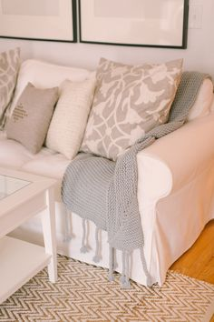White @IKEA USA couch with neutral accents from @elise West elm @cratebarrel | Photography: http://rutheileenphotography.com