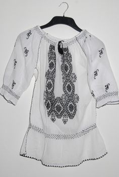Romanian ethnic blouse with black embroidery. $100.00, via Etsy.