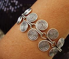 Items similar to Wire Bracelet - Etruscan swirls on Etsy