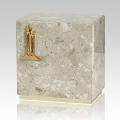 The Dignity Perlato Agglomerate Marble Cremation Urn is assembled from real natural quarried stone. The urn has 24k gold plated decoration option and the bottom has felt to protect the surface were the urn rests. This wonderful natural stone urn will create a dignified resting place for eternity to come.