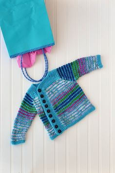 Free Pattern Friday - Left of Center Cardi knit in Universal Yarn Little Bird and Little Bird Colors.