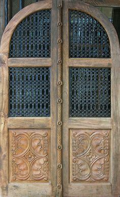 Door with carved panels in Santa Fe, NM by Michael Rymer via Flickr