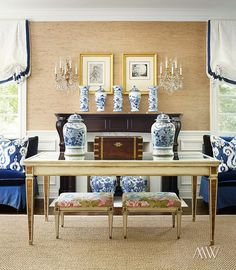 Blue and white accents in living room, grasscloth wall paper, posh, traditional interior design, Roman shades, accent pieces blue and white vases, blue and white porcelain, neutral territory, accessorize the room, lagniappe, chinoiserie chic