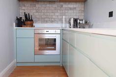 Small L shaped kitchen in aqua blue https://www.bathbespoke.co.uk/portfolio/lansdown-crescent-restoration/