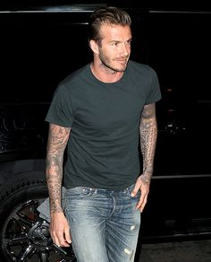Bending It in Big Apple David Beckham showed off his arm tattoos heading into dinner at NYC's Maison for dinner June 5.