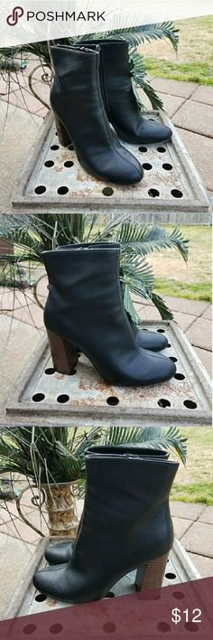 """Black Faux Leather Heeled Booties Boots 🌹I'm currently running an additional sale. See listing at the top of my closet for details.🌹  PRICE FIRM UNLESS BUNDLED!   These are in like new condition. They were only tried on and walked around in. They're unfortunately too small. They're faux leather with a faux wooden block heel that's approximately 3""""-3.5"""". I'll double check that. They seem to run true to size. They're a 7.5 medium.  Pics are part of the description! Merona Shoes Heeled Boots"""