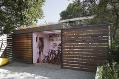 An unassuming backyard shed has barn doors that roll open on two sides, allowing it to double as a well-appointed gardener's retreat and bike storage. But when the doors are closed? You'd never guess what's inside.