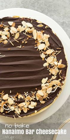 This No Bake Nanaimo Bar Cheesecake has all of the familiar flavors of the classic Nanaimo bar but in an easy no bake cheesecake! The perfect Christmas dessert (but I won't tell if you indulge year round!). Includes step by step recipe video. | no bake cheesecake | no bake dessert | chocolate | almonds | coconut
