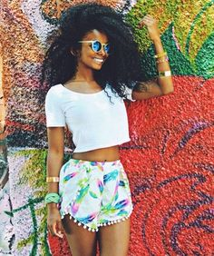 I like the combo of the crop top and shorts - especially, the shorts! The hair too adds to the 'fit. I'm also really diggin' her maim