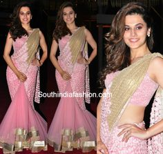 Tapsee Pannu attended the half saree function of Pearl V Potluri, PVP's daughter, in a pink and gold flared lehengasaree by Rabani and Rakha. Everything about the lehengasaree, the flare, the light pink, the subtle work over the blouse and the fabric of the palluwas to love. She matched it with a wavy hair do …