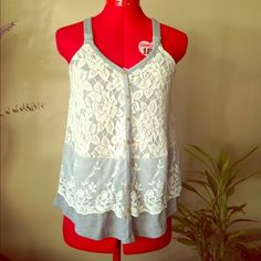 Adorable lace top Very cute cream lace panel detail over a heather grey solid background, faux buttons, adjustable racer back. NWOT excellent condition Rewind Tops
