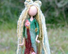 MADE TO ORDER. Needle felted roses lady. Beautiful flowers with overpowering smell. Some people might say she is too proud but I know she is not. My grandmothers garden is full of tea roses and of course there are many of tea rosess fairies that taking care about them. When I was a child I used to play with them and now my children are their friends. This needle felted standing fairy is about 9 tall, her dress is in different shades of green decorated with roses. Her hair is made out of…