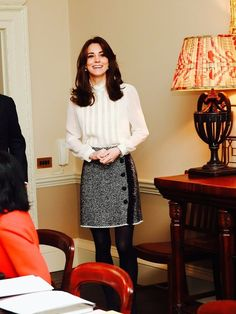 Kate Middleton wearing a Reiss blouse and Dolce & Gabbana grey tweed skirt