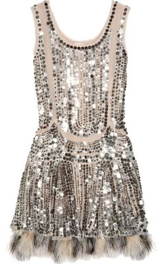 Diamond Coated Dress: Features a double scoop neckline, brilliant silver sequin trim highlighting both sides of the dress, slightly cinched waist for a figure-flattering effect, and a luxurious fur-trimmed hem to finish.
