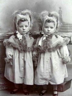 Identical twins in ultra cute outfits, ca late 19th century