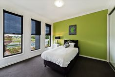 #Bedroom #ideas from Ausbuild's Segal display #home. This bright green feature wall is perfectly complimented by the basicblack and white furnishings. www.ausbuild.com.au
