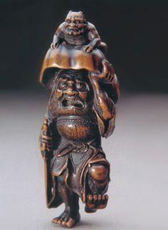shoki | Netsuke of Shoki the Demon-Queller standing on one leg, his sword ...