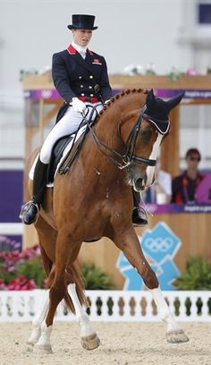 Great Britain's Bronze medalist Laura Bechtolsheimer riding Mistral Hojris during the equestrian Dressage Individual Grand Prix Freestyle today. (Photo credits: Jorge Silva/Reuters NBC Olympics)