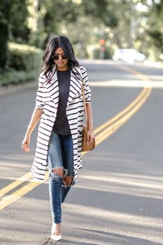 justthedesign:  Break tradition and go for a statement trench like this cute horizontally striped number. This pattern not only slims the wearer but is also eye catching and stylish! Via Sheryl Luke. Trench: Madewell, Tank: Urban Outfitters, Jeans: Citizens of Humanity, Shoes: Zara, Bag: Cuyana, Sunglasses: Rayban.